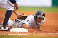 Jackson Generals third baseman Leury Bonilla (12) dives back to first on a pickoff attempt during a game against the Montgomery Biscuits on April 29, 2015 at Riverwalk Stadium in Montgomery, Alabama.  Jackson defeated Montgomery 4-3.  (Mike Janes/Four Seam Images)