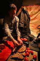 The convoy is forced to spend the night pasrked on the side of the road as there is a no diving after dark policy. The Journalist on the convoy Jeremy sits down to a harty meal of old bread and tomatoes inside the cab of the truck.