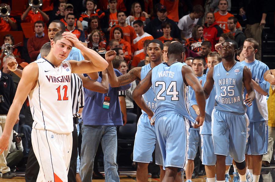 Jan. 8, 2011; Charlottesville, VA, USA;  Virginia Cavaliers guard Joe Harris (12) wipes sweat from his head after the 62-56. Mandatory Credit: Andrew Shurtleff
