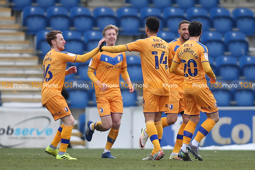 The away team players celebrate after an own goal gives Mansfield a 1-0 lead during Colchester United vs Mansfield Town, Sky Bet EFL League 2 Football at the JobServe Community Stadium on 14th February 2021