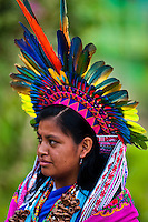 """A native from the Kamentsá tribe, wearing a colorful feather headgear, takes part in the Carnival of Forgiveness, a traditional indigenous celebration in Sibundoy, Colombia, 12 February 2013. Clestrinye (""""Carnaval del Perdón"""") is a ritual ceremony kept for centuries in the Valley of Sibundoy in Putumayo (the Amazonian department of Colombia), a home to two closely allied indigenous groups, the Inga and Kamentsá. Although the festival has indigenous origins, the Catholic religion elements have been introduced and merged with the shamanistic tradition. Celebrating annually the collaboration, peace and unity between tribes, they believe that anyone who offended anyone may ask for forgiveness this day and all of them should grant pardons."""