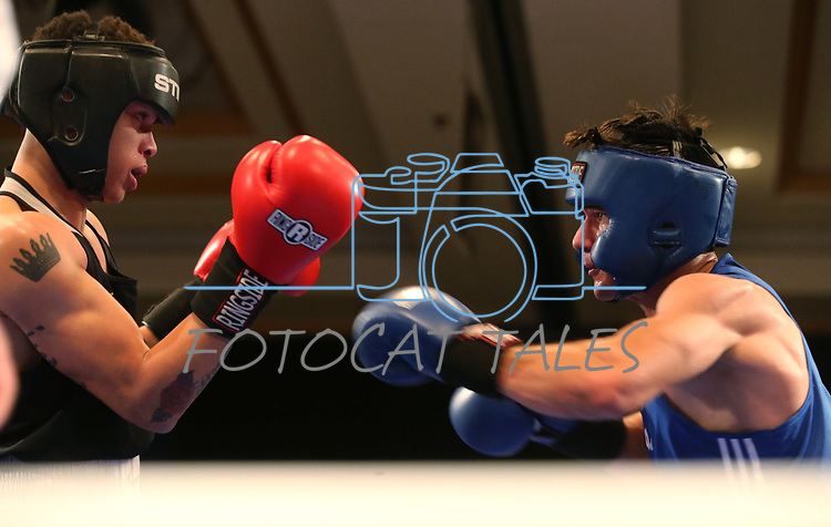 Nevada boxer Nate Strother and Air Force Academy boxer Canada Clifton Smith compete in the National Collegiate Boxing Association action in Reno, Nev. on Friday, Jan. 31, 2020. Strother won the bout. <br /> Photo by Cathleen Allison