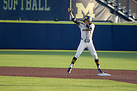 Michigan Wolverines first baseman Jake Marti (7) celebrates hitting a double in the ninth against the Michigan State Spartans on March 21, 2021 in NCAA baseball action at Ray Fisher Stadium in Ann Arbor, Michigan. Michigan scored 8 runs in the bottom of the ninth inning to defeat the Spartans 8-7. (Andrew Woolley/Four Seam Images)