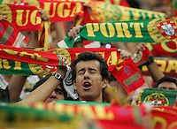 A Portuguese fan sings his country's national anthem while surrounded by scarves.  Portugal defeated England on penalty kicks after playing to a 0-0 tie in regulation in their FIFA World Cup quarterfinal match at FIFA World Cup Stadium in Gelsenkirchen, Germany, July 1, 2006.