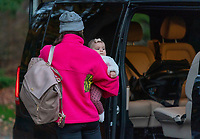 ZEIST, NETHERLANDS - NOVEMBER 20: Alex Morgan #13 of the USWNT arrives at training camp with Charlie Carrasco on November 20, 2020 in Zeist, Netherlands.