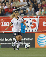 USWNT defender Kristie Mewis (8) brings the ball forward. In an international friendly, the U.S. Women's National Team (USWNT) (white/blue) defeated Korea Republic (South Korea) (red/blue), 4-1, at Gillette Stadium on June 15, 2013.