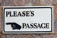 Please's Passage sign on the High Street in Totnes, England, UK. Wednesday 14 April 2021