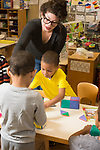 Education Preschool 3-4 year olds SEIT working with boy in classroom