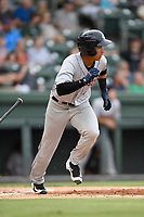 Third baseman Oswaldo Cabrera (9) of the Charleston RiverDogs bats in a game against the Greenville Drive on Thursday, July 27, 2017, at Fluor Field at the West End in Greenville, South Carolina. Charleston won, 5-2. (Tom Priddy/Four Seam Images)