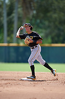 Pittsburgh Pirates shortstop Cole Tucker (3) throws to first base to try to complete a double play during a Florida Instructional League game against the Detroit Tigers on October 2, 2018 at the Pirate City in Bradenton, Florida.  (Mike Janes/Four Seam Images)