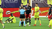 NASHVILLE, TN - SEPTEMBER 23: Frederic Brillant #13 and Steven Birnbaum #15 of DC United argue a foul with referee Tori Penso during a game between D.C. United and Nashville SC at Nissan Stadium on September 23, 2020 in Nashville, Tennessee.