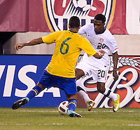 Robbie Findley (20) of the USMNT tries to get past Andre Santos (6) of Brazil during an international friendly at the New Meadowlands Stadium in East Rutherford, NJ. Brazil defeated the USMNT, 2-0.