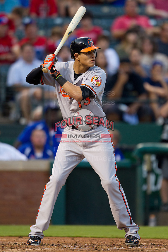 Baltimore Orioles third baseman Manny Machado #13 at bat during the Major League Baseball game against the Texas Rangers on August 21st, 2012 at the Rangers Ballpark in Arlington, Texas. The Orioles defeated the Rangers 5-3. (Andrew Woolley/Four Seam Images).