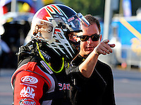 Sep 13, 2013; Charlotte, NC, USA; Billy Torrence (left) gets some instruction from his son NHRA top fuel dragster driver Steve Torrence during qualifying for the Carolina Nationals at zMax Dragway. Mandatory Credit: Mark J. Rebilas-