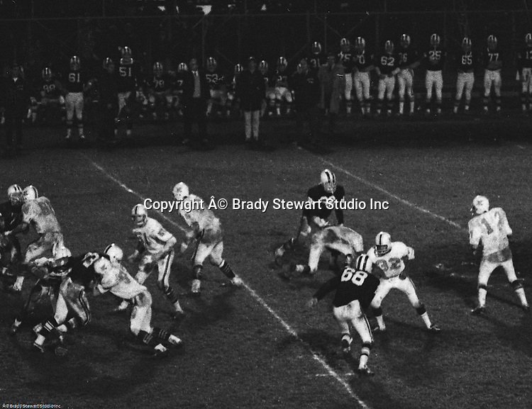 Bethel Park PA:  Mike Stewart throwing a pass to Bruce Evanovich for a first down after great blocks from the offensive line and backs.  Others in the photo; Gary Biro 81, Clark Miller 40, Chip Huggins 32, Don Troup 51, Bob Hensler 77,   The Bethel Park offense and defense played very well in the 16-0 shut out of the Upper St Clair Panthers. The defensive unit was one of the best in Bethel Park history only allowing a little over 7 points a game.