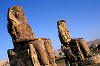 The Colossi of Memnon, two massive stone statues of Pharaoh Amenhotep III, in the Theban necropolis, Luxor, Egypt.