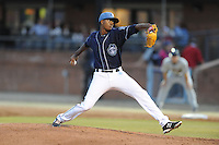Asheville Tourists starting pitcher Johendi Jiminian #31 delivers a pitch during opening night game against the Delmarva Shorebirds at McCormick Field on April 3, 2014 in Asheville, North Carolina. The Tourists defeated the Shorebirds 8-3. (Tony Farlow/Four Seam Images)