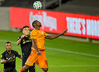 CARSON, CA - OCTOBER 28: Maynor Figueroa #15 of the Houston Dynamo heads a ball during a game between Houston Dynamo and Los Angeles FC at Banc of California Stadium on October 28, 2020 in Carson, California.