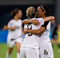 Angela Hucles, Amy Rodriguez. The USWNT defeated New Zealand, 4-0, during the 2008 Beijing Olympics in Shenyang, China.  With the win, the USWNT won group G and advanced to the semifinals.