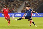 Haraguchi Genki of Japan (R) competes for the ball with Saad Al Mukhaini of Oman (L) during the AFC Asian Cup UAE 2019 Group F match between Oman (OMA) and Japan (JPN) at Zayed Sports City Stadium on 13 January 2019 in Abu Dhabi, United Arab Emirates. Photo by Marcio Rodrigo Machado / Power Sport Images