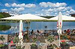 Austria, Tyrol, near Kitzbuhel: Café and restaurant at idyllic Schwarzsee (Black Lake) on the outskirts of Kitzbuhel | Oesterreich, Tirol, bei Kitzbuehel: Café und Restaurant am Schwarzsee, idyllisch gelegener Badesee, 8 ha gross und bis zu 8 m tief, einer der waermsten Seen der Alpen