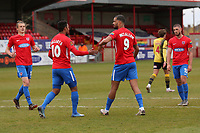 Paul McCallum of Dagenham and Redbridge scores the second goal for his team from the penalty spot and celebrates with his team mates  during Dagenham & Redbridge vs Woking, Vanarama National League Football at the Chigwell Construction Stadium on 3rd May 2021