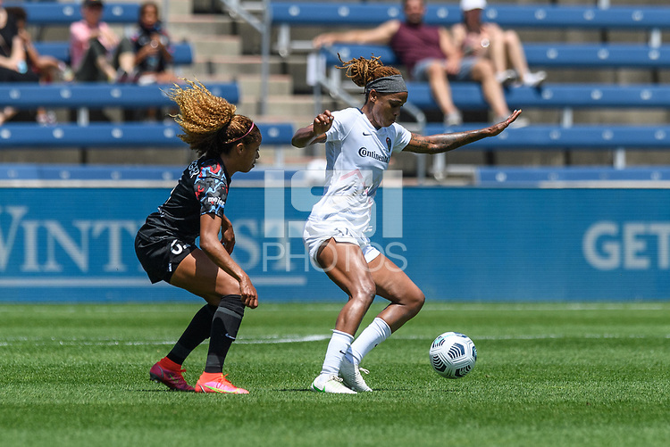 BRIDGEVIEW, IL - JUNE 5: Jessica McDonald #14 of the North Carolina Courage dribbles the ball as Casey Krueger #6 of the Chicago Red Stars defends during a game between North Carolina Courage and Chicago Red Stars at SeatGeek Stadium on June 5, 2021 in Bridgeview, Illinois.