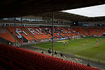 Portsmouth on the attached in front of the near-deserted home stands at Bloomfield Road stadium as Blackpool hosted Portsmouth in an English League One fixture. The match was proceeded by a protest by around 500 home fans against the club's controversial owners Owen Oyston, many of whom did not attend the game. The match was won by the visitors by 2-1 with two goals by Ronan Curtis watched by just 4,154 almost half of which were Portsmouth supporters.