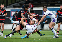 Rhys Curran of London Broncos with a big tackle during the Betfred Championship match between London Broncos and Newcastle Thunder at The Rock, Rosslyn Park, London, England on 9 May 2021. Photo by Liam McAvoy.