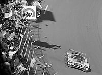 The #00 March-Porsche 83G of Sarel van der Merwe, Graham Duxbury and Tony Martin takes the ckeckered flag to win the SunBank 24 at Daytona, Daytona International Speedway, Daytona Beach, FL, Feb. 4-5, 1984. (Photo by Brian Cleary/www.bcpix.com)