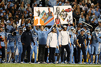 CHAPEL HILL, NC - NOVEMBER 02: Play calling cards are held up on the University of North Carolina sideline during a game between University of Virginia and University of North Carolina at Kenan Memorial Stadium on November 02, 2019 in Chapel Hill, North Carolina.