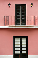 Uruguay, Colonia de Sacramento, Balcony above black door, restored historic building, UNESCO site