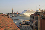 Italy, Venice.  Ask for a Room with a View.<br /> I took Rick Steves' advice regarding inexpensive lodging with an incredible view. He was right. These cruise ships and their guests are in port from about 9AM to 4:30PM, so visit the most popular sites before and after. I call it anti-patterning.<br /> Grand Canal near San Marco Square, Venice.