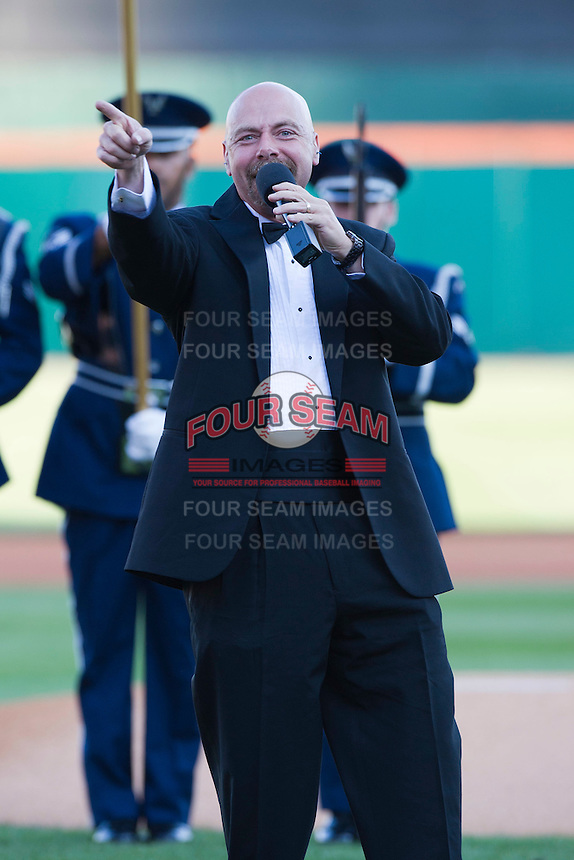 Buffalo Sabres national anthem singer Doug Allen points to the crowd while finishing the anthem during the Triple-A All-Star Game Coca-Cola Field on July 11, 2012 in Buffalo, New York.  The Pacific Coast League defeated the International League 3-0.  (Mike Janes/Four Seam Images via AP Images)