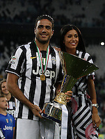 Calcio, Serie A: Juventus vs Napoli. Torino, Juventus Stadium, 23 maggio 2015. <br /> Juventus' Alessandro Matri, flanked by his girlfriend Federica Nargi, celebrates the victory of the Scudetto at the end of the Italian Serie A football match between Juventus and Napoli at Turin's Juventus Stadium, 23 May 2015.<br /> UPDATE IMAGES PRESS/Isabella Bonotto