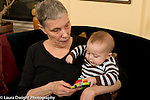 5 month old baby boy with grandmother shown toy