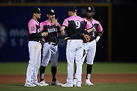 (L-R) Charlotte Knights infielders Zach Remillard (7), Matt Reynolds (1), Jake Lamb (9), and Ti'Quan Forbes (10) wait for a new pitcher to complete his warm-ups during the game against the Gwinnett Stripers at Truist Field on July 17, 2021 in Charlotte, North Carolina. (Brian Westerholt/Four Seam Images)