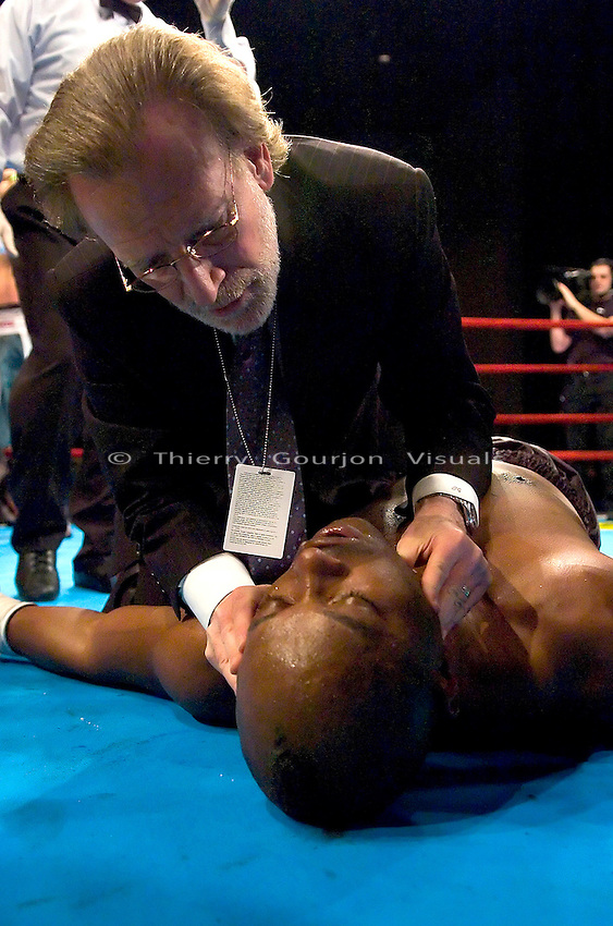 A doctor attends to Ronald Lee Bellamy as he lies unconscious during his 12 Rounds Heavyweight fight against Timor Ibragimov at Madison Square Garden in New York City on March 3rd, 2005. Ibragimov won the fight by a 3rd round KO.