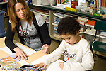 Education Elementary Public Grade 2 para -professional working with special needs student in science specialists' class horizontal