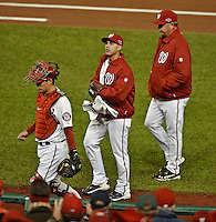 12 October 2012: Washington Nationals pitcher Gio Gonzalez (center) walks to the dugout flanked pitching coach Steve McCatty and catcher Kurt Suzuki prior to Postseason Playoff Game 5 of the National League Divisional Series against the St. Louis Cardinals at Nationals Park in Washington, DC. The Cardinals rallied with four runs in the 9th inning to defeat the Nationals 9-7; thus winning the NLDS and moving on to the NL Championship Series. Mandatory Credit: Ed Wolfstein Photo