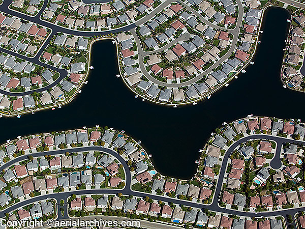aerial photograph rows of residential development built around water in Sacramento, California