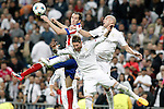 Real Madrid's Sergio Ramos (c) and Pepe (r) and Atletico de Madrid's Diego Godin during Champions League 2014/2015 Quarter-finals 2nd leg match.April 22,2015. (ALTERPHOTOS/Acero)