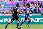 Murphy Paulo of Samoa (R) runs with the ball during the HSBC Hong Kong Sevens 2018 match between New Zealand and Samoa on April 7, 2018 in Hong Kong, Hong Kong. Photo by Marcio Rodrigo Machado / Power Sport Images