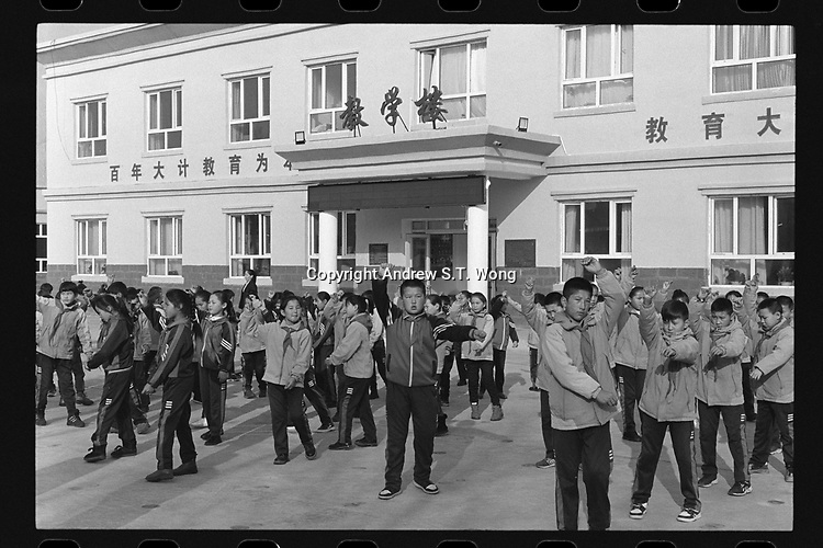 Jeminay County, Xinjiang Uygur Autonomous Region, China - Primary students exercise after class, October 2019.