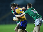 Cillian Brennan of Clare  in action against David Connolly of Limerick during the Mc Nulty Cup U-21 final at The Gaelic Grounds. Photograph by John Kelly.