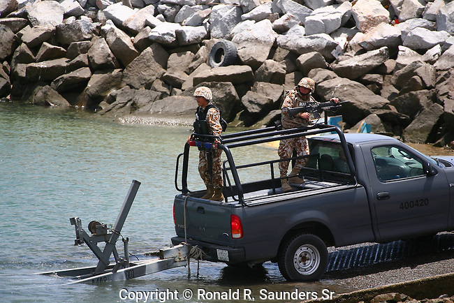 SOLDIERS IN TRUCK UNLOAD NAVY BOAT AT MARINA IN SAN FELIPE