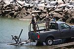SOLDIERS IN TRUCK UNLOAD NAVY BOAT AT MARINA IN SAN FELIPE