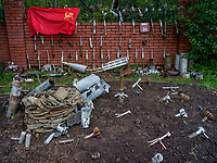 Ukrainian engineers have collected grenades, mines and other war materiel in this unofficial museum which they also use to teach others about the many dangers what face soldiers and civilians in the ongoing conflict between Ukrainian government forces and Russian-backed separatists in the east of the country<br /> <br /> The national flag of the former Soviet Union, taken from one of the separatist's positions, hangs on a wall. The flag is widely used by the Russian-backed separatists as a nostalgic symbol of the past glory, wealth and strength of the former Soviet empire.