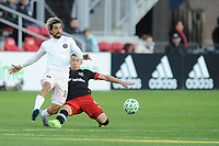 WASHINGTON, DC - MARCH 07: Rodolfo Pizarro #10 of Inter Miami CF battles the ball with  Russell Canouse #4 of D.C. United during a game between Inter Miami CF and D.C. United at Audi Field on March 07, 2020 in Washington, DC.