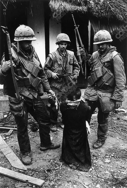 U.S. Marines with a captured civilian, suspected of being a North Vietnamese sympathizer, Têt offensive, Battle of Hué, Vietnam, February 1968